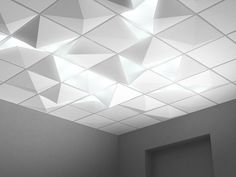 Pool's W&W recessed ceiling light transforms dull suspended ceilings into fractured landscapes.