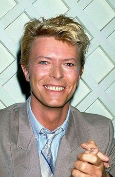 David Bowie 80s, and he's smiling!