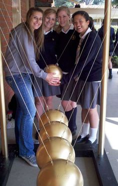 Louisville High School ~ AP Physics makes giant Newton's Cradle Online Physics Tutor, Physics Help, Science Resources, Teaching Science, Momentum Physics, Newton's Cradle, High School Science, Outdoor Classroom, Positive And Negative
