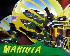 A detailed look at Oregon's new Lightning Yellow, Carbon Fiber helmet from the Sept. 1 season opener. (Photo by Chris Pietsch/Register Guard)