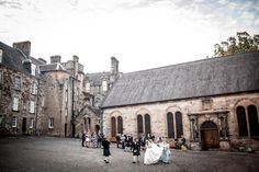 bridal party and guests walking through the Stirling Castle courtyard Stirling Castle, San Francisco, Walking, Street View, Wedding Photography, In This Moment, Bridal, Party, Walks