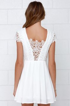 Luxuriously lacy and rich in style and sophistication, the Lavish in Lace Ivory Lace Dress is perfect for every occasion! A fitted bodice with princess seams features a deep V neckline paired with a plunging V back covered in sheer lace. Sheer short sleeves, and a pleated skater skirt bring a delicate touch to this flirty fit and flare dress. Hidden side zipper. Partially lined. 100% Polyester. Hand Wash Cold.