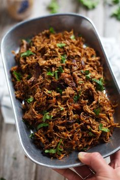Super Easy Crockpot Shredded Pork - and a trick for getting those deliciously golden crispy bits!   pinchofyum.com