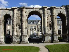 The Porte de Mars, Reims, France, once led to the ancient town of Durocortorum. Built in the 3rd Century AD, the Corinthian columns support the huge arch, 32 metres long X 13 metres high. As you walk through the arch, it's still possible to see wagon tracks. (photo was taken in 2002) photo©jadoretotravel