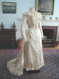 "1899 Wedding Dress, Gale Gaylard (New York): silk satin, boned bodice, lined with silk, satin ribbon, organdy  and ruffled satin. ""Anna Pingree Wheatland married Stephen Willard Phillips on June 15, 1899."""