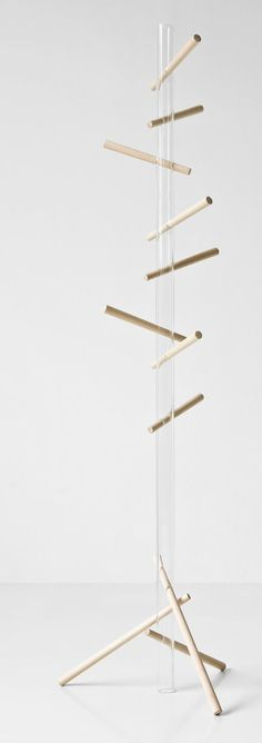 Woodpecker by mist-o (tommaso nani + noa ikeuchi)  Clothes stand made of lime tree wood and Plexiglas. TIP: the wooden pegs can be removed and put into the Plexiglas pipe.