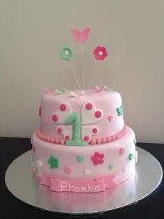 Phoebe's 1st Birthday cake. Theme is pink & green with flowers & butterflies ♥