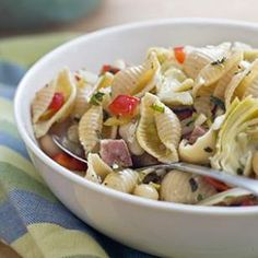 i make a damn good pasta salad, but this one's got a dressing i've got to try. they sub in chicken broth in place of some of the oil.