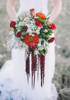 cascading red bouquet by Laura Bogdan