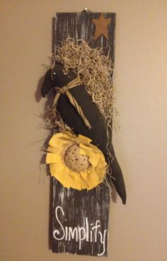 Black crow and sunflower on a board. Cute.