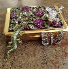 Victorian garnet salamander, Edwardian diamond frog and diamond butterfly have assembled on a bed of flowers in peridot and pink sapphires. #forsale #vintagejewelry #Victorian #Edwardian #animaljewelry