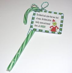**New** Grinch tag with bakers twine included. YOU GET: A sheet of 9 Grinch tags with bakers twine. Just tie around green candy canes Tag says: Grinch Party, Le Grinch, Grinch Christmas Party, Christmas Party Favors, Xmas Party, Christmas Goodies, Christmas Treats, Holiday Fun, Christmas Holidays