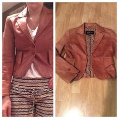 Super soft leather jacket Rust colored leather jacket. Soooo soft! Wear on sleeves, as shown in photos. Otherwise great condition! Looks great on, and it feels like butter  Guess Jackets & Coats
