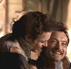 """Stop it, you two  (Robert Downey Jr. and Jude Law in an affectionate moment during filming of """"Sherlock Holmes: A Game of Shadows"""")"""