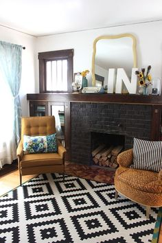 Extended mantel to create bookcases on either side of fireplace.