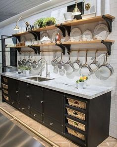 7 Favorite Kitchen & Bath Trends Fabulous La Cornue kitchen with open shelving, brass pot rack, swing-arm sconces, and cabinets with pull-out baskets Kitchen Redo, Kitchen And Bath, Kitchen Storage, Kitchen Remodel, Open Cabinet Kitchen, Open Kitchen Shelving, Kitchen Organization, Open Kitchen Diy, Dirty Kitchen Ideas