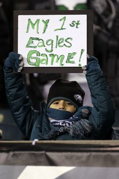 A playoff win over the Atlanta Falcons? This kid picked a good one. (AP/Szagola)
