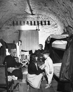 David Day is prepared for bed in his home in a cave in Dover's chalk cliffs in Dover England April 19 About 90 people were permanent residents of caves to evade German shells and bombs. David remembers no other home having become a cave dweller at Oscar Wilde, Women In History, World History, Dover England, Photos Rares, The Blitz, 5 Year Olds, Back In The Day, World War Two