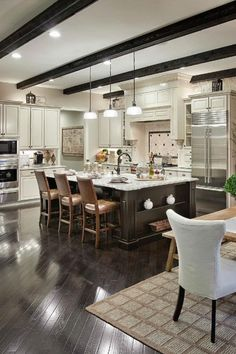 What would you prefer? A two-tone kitchen design, or all the same color cabinets? Kitchen by Possibilities for Design