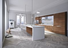 #Kitchen Time with #doors in #wood Canaletto walnut and #worktop in white Solid Surface.