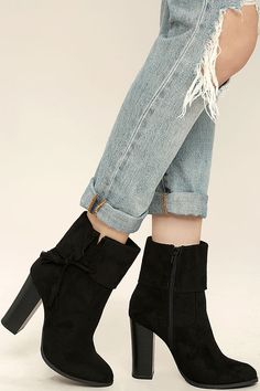 """Be bold in your fashion choices with the All on the Line Black Suede High Heel Booties! Vegan suede is a dream over an almond toe upper, and seamed vamp topped by a folded collar with tassel accent. 7"""" zipper at the instep."""