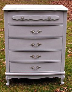 Annie Sloan Chalk Paint -- first coat a mix of blues, second coat Paris Grey, lightly distressed, clear wax.