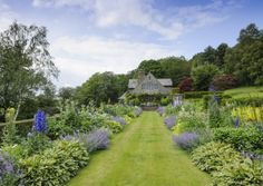 The turn of the 20th century saw gardens become rural idylls crafted around the house, with natural materials, formal design and ebullient planting