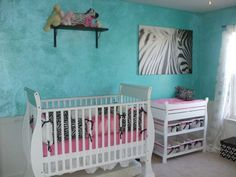 teal blue and light pink baby girl nursery with black and white zebra touches