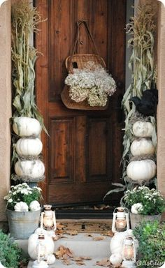 White washed pumpkin and lantern entryway
