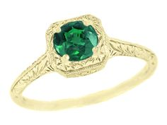 Engraved Scrolls Filigree Emerald Engagement Ring in 14 Karat Yellow Gold - A beautiful and affordable yellow gold emerald engagement ring.  Yellow gold is a wonderful complement to the deep green of emerald gemstones. $395  -   http://www.antiquejewelrymall.com/r183y.html