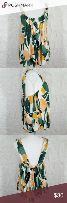 "Anthro Vanessa Virginia Tie Back Flowy Tank #169 Hi Guys! i'm Selling this Adorable Anthropologie Vanessa Virginia Top! It's a size Large in Great Condition! it has 2 ties on the back that can be tied or left down. it has a cream colored lining and a lovely spring leaf/floral printed soft fabric! Measurements: Pit to pit is 17.5"". Length 26.5"". Anthropologie Tops"