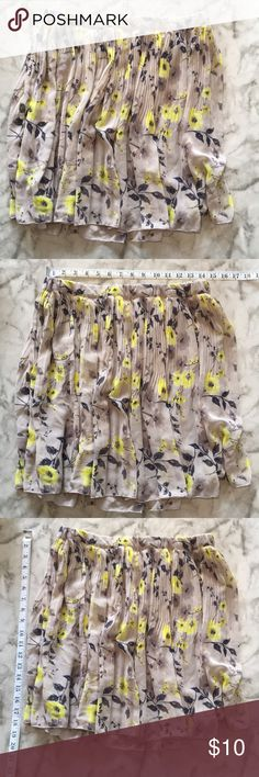 Old Navy Floral Skirt Grey swing skirt with yellow and purple floral print. Elastic waist. Great skirt for spring or summer.   Size - Medium Shell/lining - 100% Polyester Old Navy Skirts Mini