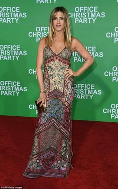 Eye-catching: Aniston's colorful embroidered and embellished full-length frock showcased h...