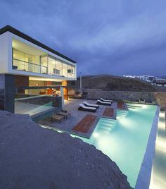A house on the cliffs, with an infinity pool. Love!