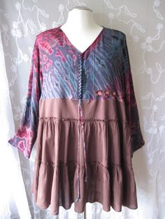 Bohemian cottage chic top with plums, blues, magenta, brown, 3 pink buttons and gypsy tie. Pretty with jeans and boots.  Bust 50  Hips open size