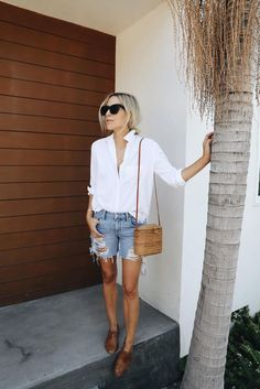 Denim shorts and white blouse outfit on Damsel in Dior