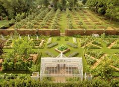 Gainesway Farm, Lexington, Kentucky - The walled garden with the orchard beyond. Photo Credit: Pieter Estersohn
