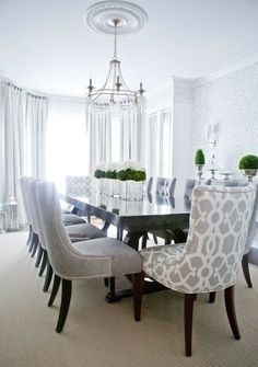 Lux Decor: Elegant dining room with silvery gray damask wallpaper and dark hardwood floors layered in creamy white rugs