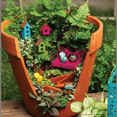 Cool Broken pot turned into a tiny bird house :D