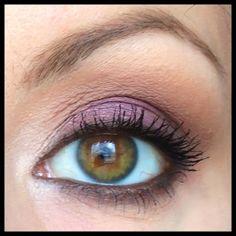 Purple and muted orange make hazel eyes pop