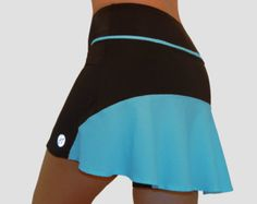 Blue water, golden sand beaches, palm trees and sunny days. The Neon Coral color of this skort reminds us about relaxing days of coral reefs diving.   Great for running, marathons, tennis, hiking, golf, yoga, dance practice.   Also available in light blue, neon yellow and green colors.    Features - Ultra comfortable wide waistband - Light weight skirt - Built-in compression shorts - Silky-stretchy performance fabric - One hidden waistband pocket for holding credit cards, key, badge or gels…