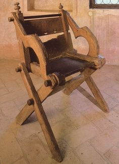 a glasonbury style chair from the study in Petrarachs House in Padua Italy.