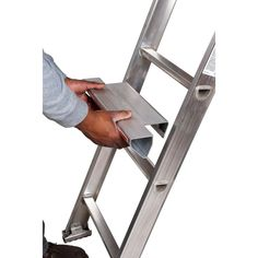 The Guardian Fall Protection Ladder Rung Step is constructed of reinforced aluminum for long lasting durability. Home Tools, Diy Tools, Vinyl Siding Installation, Roofing Tools, Garage Addition, Construction Tools, Scaffolding, Diy Garage, Machine Tools