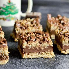 Front view of six No-Bake Chocolate Peanut Butter Oat Bars arranged in two rows of three