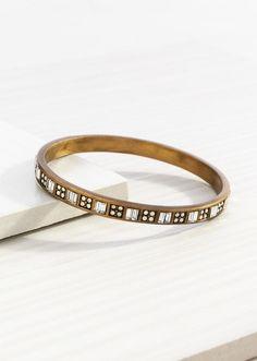"Modern Maven #Bracelet  KRB0007 | RETIRING  Was $59.00  NOW  $41.30       Brass Bracelet inset with twinkling Swarovski crystals showcases simplicity at its finest.  Diameter: 2.50""  Material: #Brass, #Swarovski™"