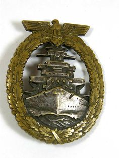 Kriegsmarine High Seas Fleet Badge by Schwerin, Berlin. This early period tombak badge displays the excellent quality of Schwerin. The badge shows wear to the finish giving it a fine age patina. The reverse displays standard Schwerin construction in the hinge and catch assemblies along with the maker's name.