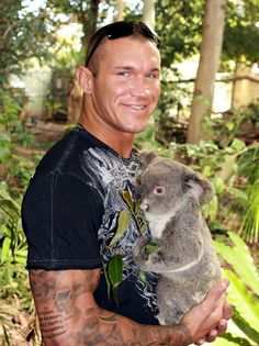 Randy Orton, WWE    oh my gosh........... I AM NOT SURE WHO IS CUTER........ WOW.........