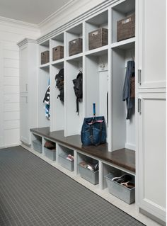 Mud Room - Single stained wooden bench surface with painted cubbies. Open shelving for baskets above and below. Room to add full length cabinets on one end? Don't like the trim here - match existing trim in rest of home.