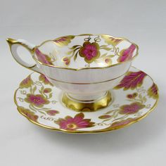 Tea cup and saucer made by Royal Stafford, tea cup and saucer have pink and gold flowers. Gold trimming on cup and saucer edges. Excellent condition (see photos). Markings read: Royal Stafford Bone China Made in England Est 1845 Please bear in mind that these are vintage items and