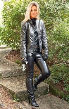 Blonde in leather jacket shirt pants and gloves